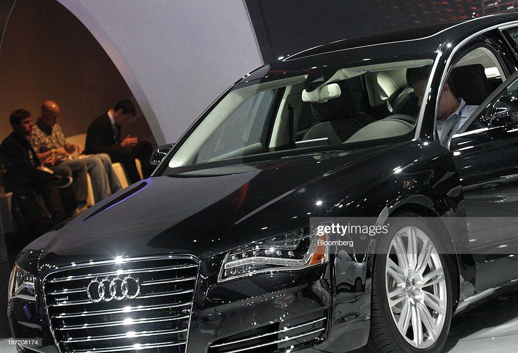 An attendee views an Audi AG vehicle at the company's booth during the LA Auto Show in Los Angeles, California, U.S., on Thursday, Nov. 29, 2012. The LA Auto Show is open to the public Nov. 30 through Dec. 9. Photographer: Jonathan Alcorn/Bloomberg via Getty Images