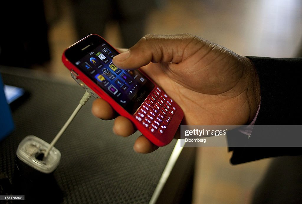 An attendee views the BlackBerry Q5 smartphone during the company's annual general meeting in Waterloo, Ontario, Canada, on Tuesday, July 9, 2013. BlackBerrys chances of becoming a viable contender to Apple Inc. and Google Inc. in the smartphone market are dimming amid lackluster demand for its flagship touch-screen device. Photographer: Pawel Dwulit/Bloomberg via Getty Images