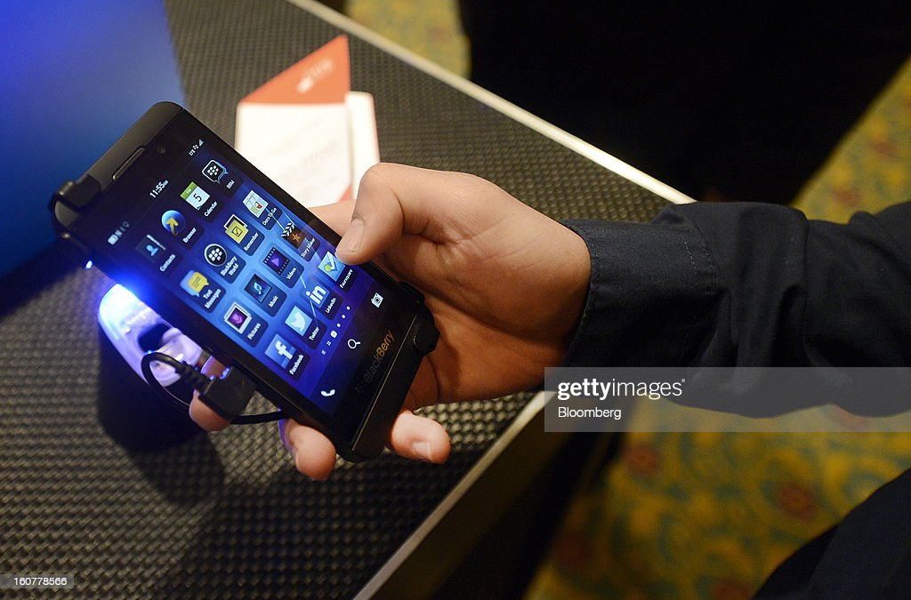 "An attendee views the BlackBerry Z10 device during an event at the Empire Club of Canada in Toronto, Ontario, Canada, on Tuesday, Feb. 5, 2013. Thorsten Heins, chief executive officer of BlackBerry, said early sales of the Z10 smartphone are ""encouraging"" and that users are switching from other platforms. Photographer: Aaron Harris/Bloomberg via Getty Images"