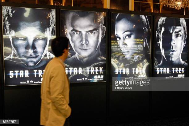 An attendee walks by movie posters for the new Star Trek film at the Paris Las Vegas during ShoWest the official convention of the National...