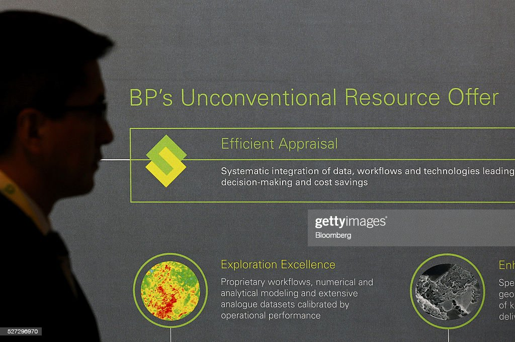 An attendee walks past a a BP Plc chart during the 2016 Offshore Technology Conference (OTC) in Houston, Texas, U.S., on Monday, May 2, 2016. The OTC gathers energy professionals to exchange ideas and opinions to advance scientific and technical knowledge for offshore resources. Photographer: Aaron M. Sprecher/Bloomberg via Getty Images