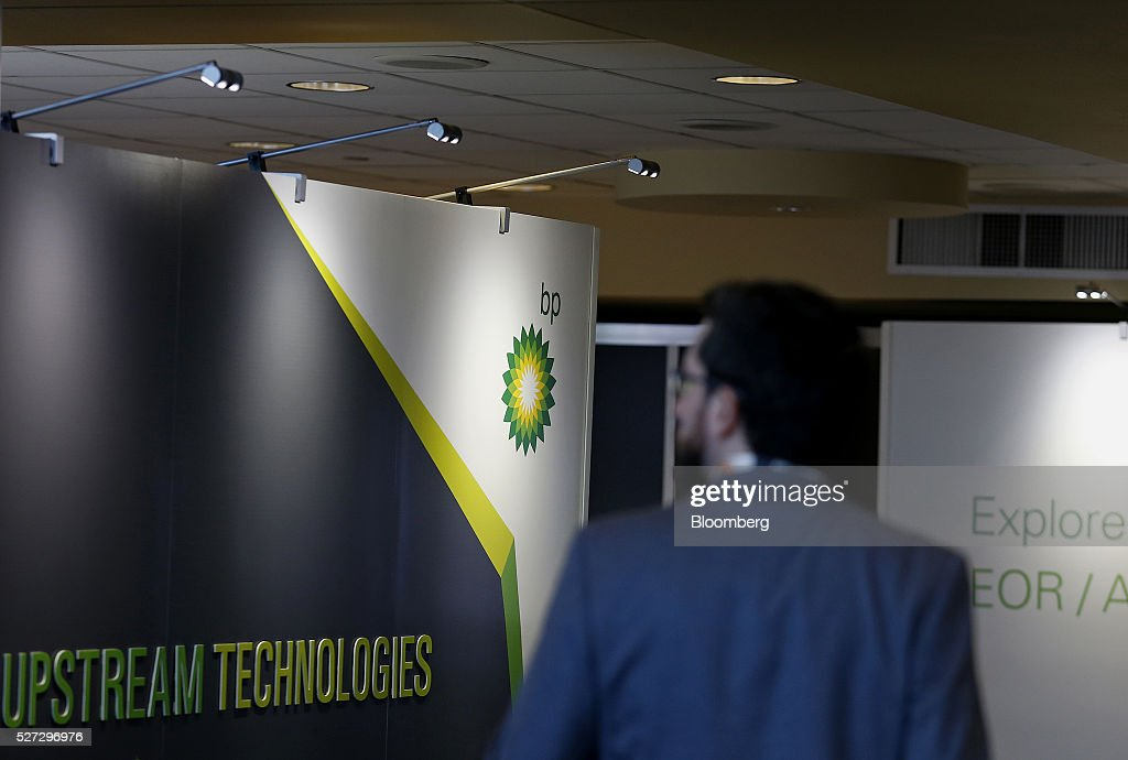 An attendee walks past a a BP Plc signage displayed during the 2016 Offshore Technology Conference (OTC) in Houston, Texas, U.S., on Monday, May 2, 2016. The OTC gathers energy professionals to exchange ideas and opinions to advance scientific and technical knowledge for offshore resources. Photographer: Aaron M. Sprecher/Bloomberg via Getty Images