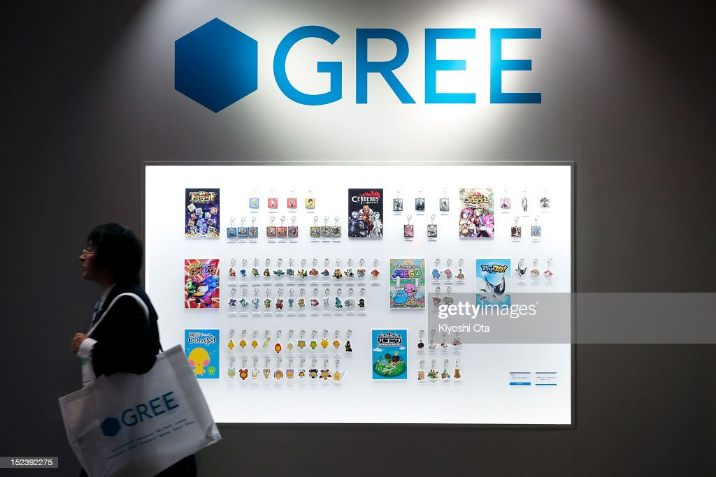 An attendee walks past a display of keyholders of characters from Gree Inc.'s mobile game titles at the company's booth during the Tokyo Game Show 2012 at Makuhari Messe on September 20, 2012 in Chiba, Japan. The annual video game expo, which is held from September 20 to 23, attracts thousands of business visitors and the general public with exhibitions of the upcoming game software and latest hardware.