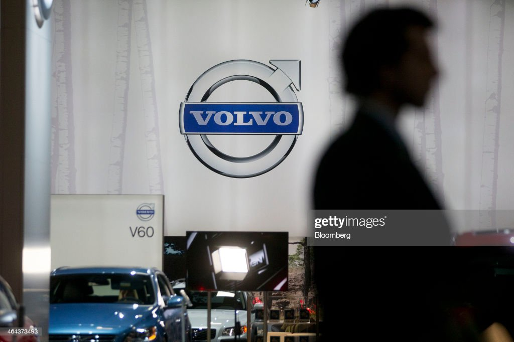 An attendee walks past the Volvo Cars stand during the Washington Auto Show in Washington, D.C., U.S., on Wednesday, Jan. 22, 2014. Volvo Cars, owned by China's Zhejiang Geely Holding Group Co., said on Jan. 9 that global sales grew 1.4% in 2013 to 427,840 vehicles. Photographer: Andrew Harrer/Bloomberg via Getty Images