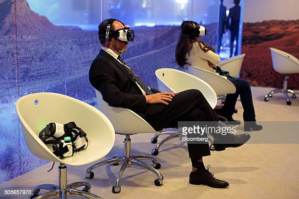 An attendee watches 'Collisions' a 15 minute film by artist Lynette Wallworth on a Samsung Gear VR virtual reality headset developed jointly by...