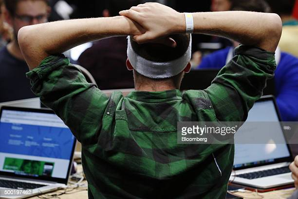 An attendee wearing a sweat band reacts as he participates in the TechCrunch Disrupt London 2015 Hackathon in London UK on Saturday Dec 5 2015...