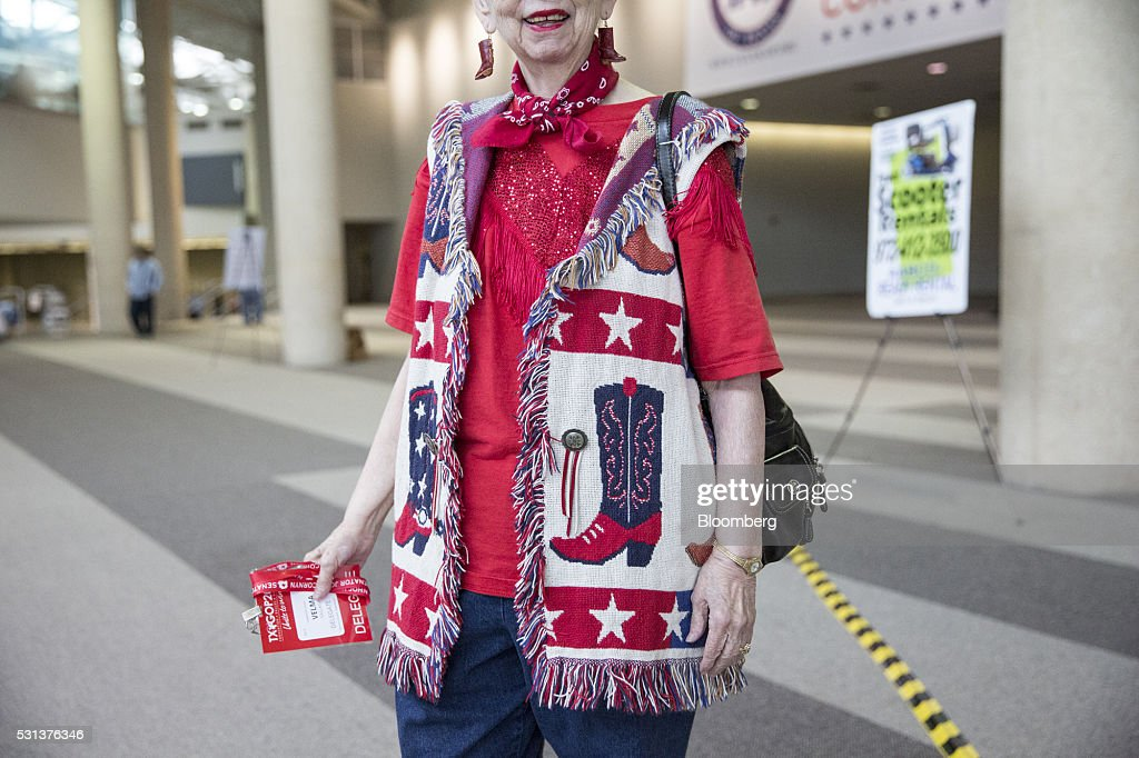 An attendee wearing American flag themed clothing stands for a photograph during the 2016 Texas Republican Convention in Dallas Texas US on Saturday...