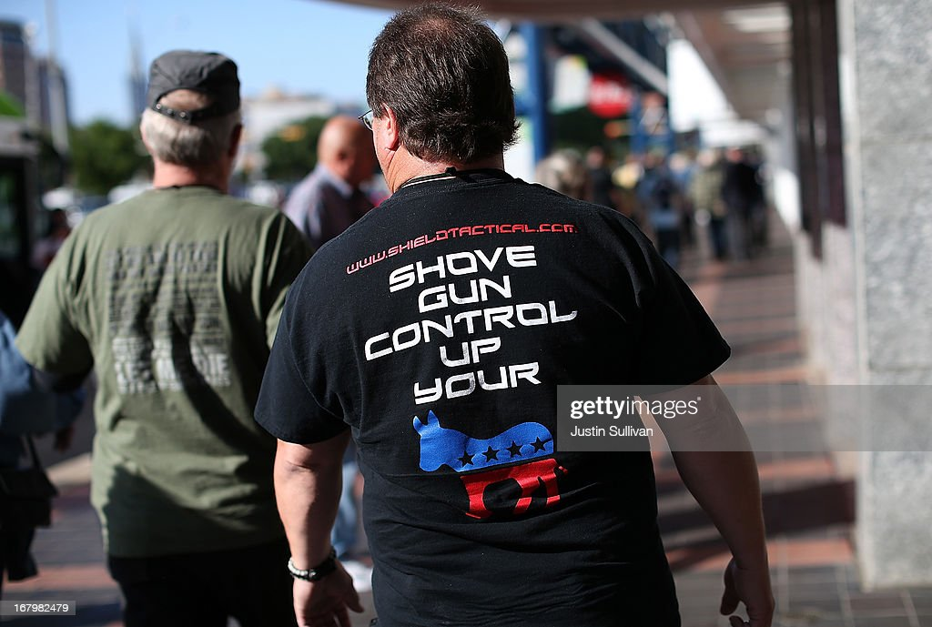 An attendee wears a Anti-gun control t-shirt during the 2013 NRA Annual Meeting and Exhibits at the George R. Brown Convention Center on May 3, 2013 in Houston, Texas. More than 70,000 peope are expected to attend the NRA's three-day annual meeting that features nearly 550 exhibitors, gun trade show and a political rally. The Show runs from May 3-5.