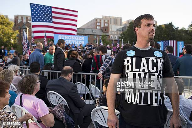 An attendee wears a Black Lives Matter tshirt while standing in the crowd ahead of a campaign event with Hillary Clinton 2016 Democratic presidential...