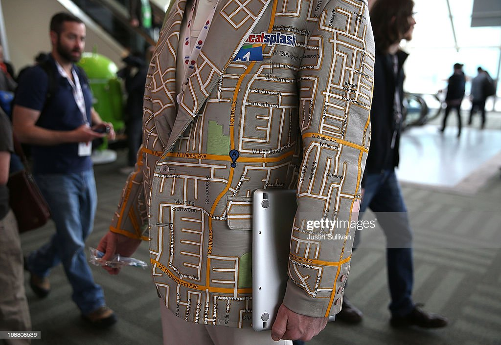 An attendee wears a custom made Google maps leather coat during the Google I/O developers conference at the Moscone Center on May 15, 2013 in San Francisco, California. Thousands are expected to attend the 2013 Google I/O developers conference that runs through May 17. At the close of the markets today Google shares were at all-time record high at $916 a share, up 3.3 percent.