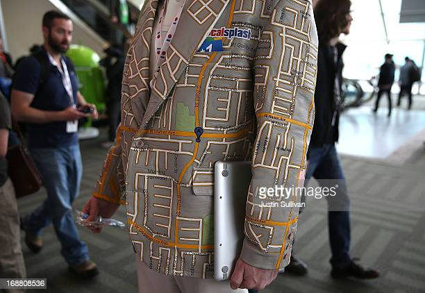 An attendee wears a custom made Google maps leather coat during the Google I/O developers conference at the Moscone Center on May 15 2013 in San...
