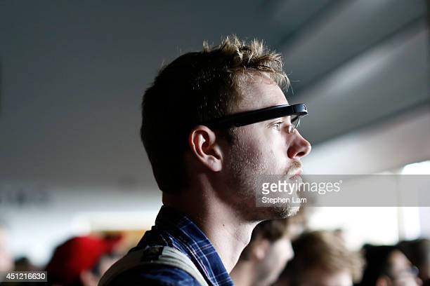 An attendee wears a Google Glass during the Google I/O Developers Conference at Moscone Center on June 25 2014 in San Francisco California The...