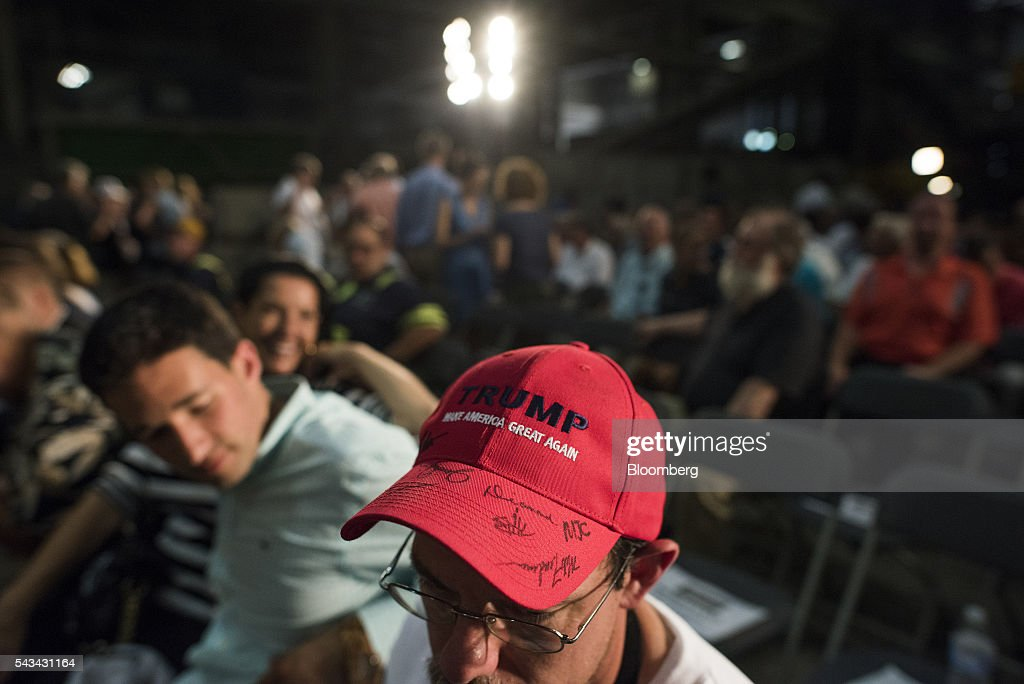 An attendee wears a hat autographed by <a gi-track='captionPersonalityLinkClicked' href=/galleries/search?phrase=Donald+Trump+-+Born+1946&family=editorial&specificpeople=118600 ng-click='$event.stopPropagation()'>Donald Trump</a>, presumptive Republican presidential nominee, not pictured, before the start of a campaign event in Monessen, Pennsylvania, U.S., on Tuesday, June 28, 2016. President Barack Obama said Trump is a lifetime member of the 'global elite' who is trying to stir up in the U.S. the kind of anti-immigrant sentiment that drove Britain to vote itself out of the European Union. Photographer: Ty Wright/Bloomberg via Getty Images