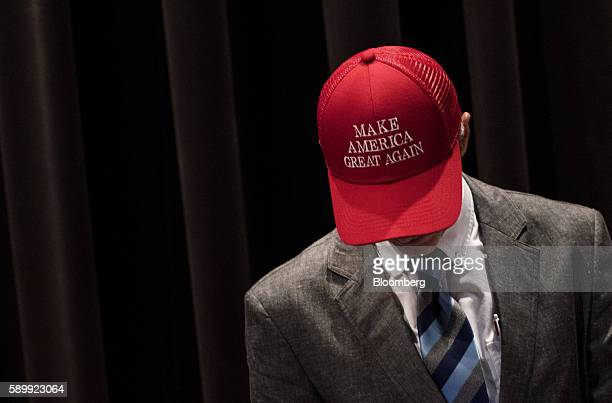 An attendee wears a hat reading 'Make America Great Again' before a campaign event with Donald Trump 2016 Republican presidential nominee at...