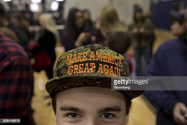 An attendee wears a hat that reads 'Make America Great Again' during a campaign event for Donald Trump president and chief executive of Trump...