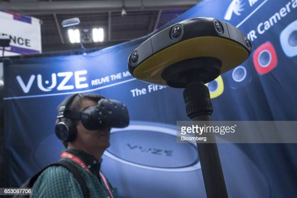 An attendee wears a HTC Vive virtual reality headset as he views data from a Vuze 360 degree camera at the 2017 South By Southwest Interactive...