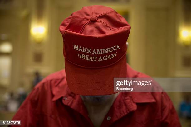 An attendee wears a 'Make America Great Again' hat before the start of a campaign rally for Donald Trump 2016 Republican presidential nominee at the...