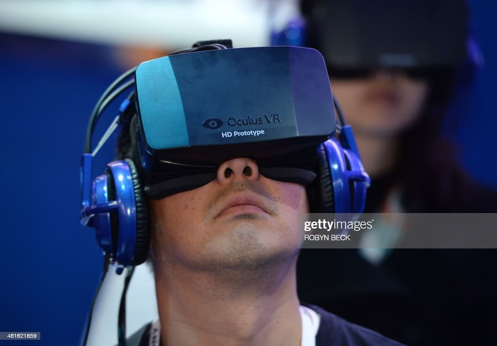 An attendee wears an Oculus Rift HD virtual reality head-mounted display at he plays
