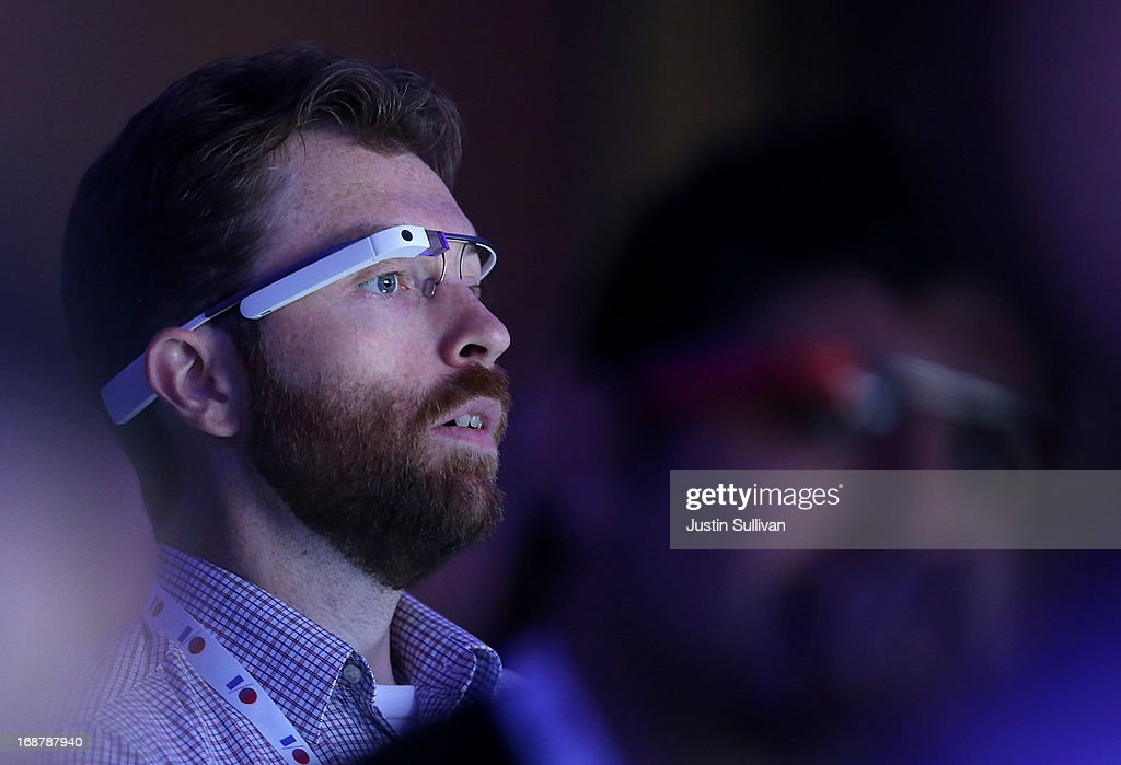 An attendee wears Google Glass as he watches the opening keynote at the Google I/O developers conference at the Moscone Center on May 15, 2013 in San Francisco, California. Thousands are expected to attend the 2013 Google I/O developers conference that runs through May 17.