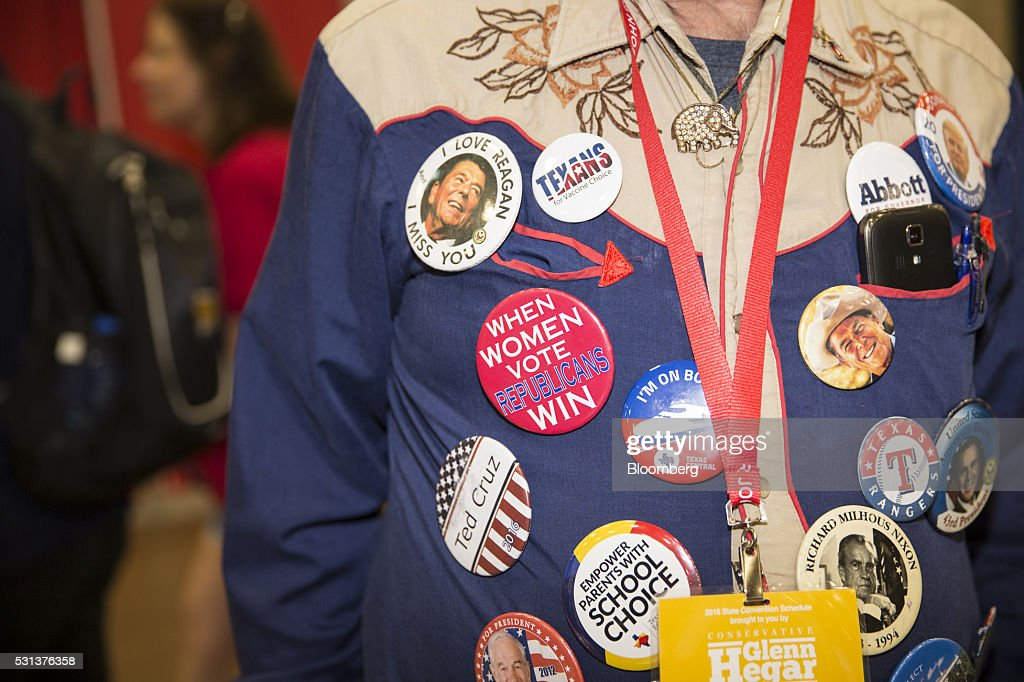 An attendee wears Republican political buttons during the 2016 Texas Republican Convention in Dallas Texas US on Saturday May 14 2016 Paul Ryan made...