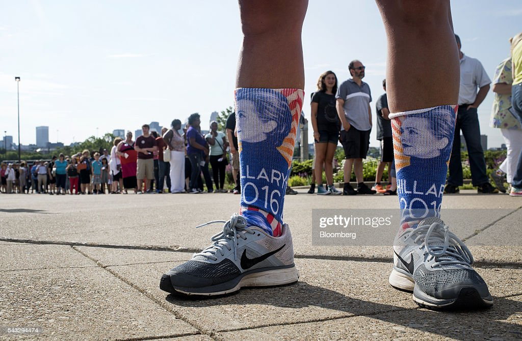 An attendee wears socks in support of Hillary Clinton, former Secretary of State and presumptive Democratic presidential nominee, not pictured, ahead of a campaign event in Cincinnati, Ohio, U.S., on Monday, June 27, 2016. Clinton released a new national television ad on Sunday attacking likely Republican rival Donald Trump for his comments on the U.K's decision to leave the European Union, and later warned of the negative impact that 'bombastic' behavior can have at times of crisis. Photographer: Ty Wright/Bloomberg via Getty Images