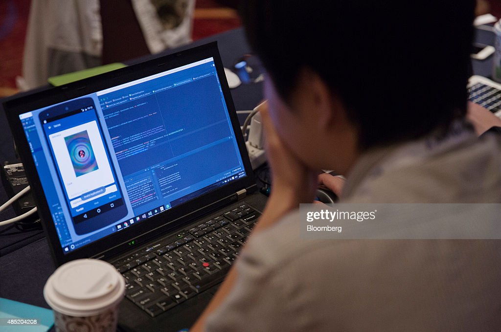 An attendee working on a laptop computer participates in the Yahoo! Inc. Mobile Developer Conference Hackathon in New York, U.S., on Tuesday, Aug. 25, 2015. The Hackathon is an opportunity for mobile developers to come together and hack around the Yahoo! Inc. Mobile Developer Suite. Photographer: Victor J. Blue/Bloomberg via Getty Images