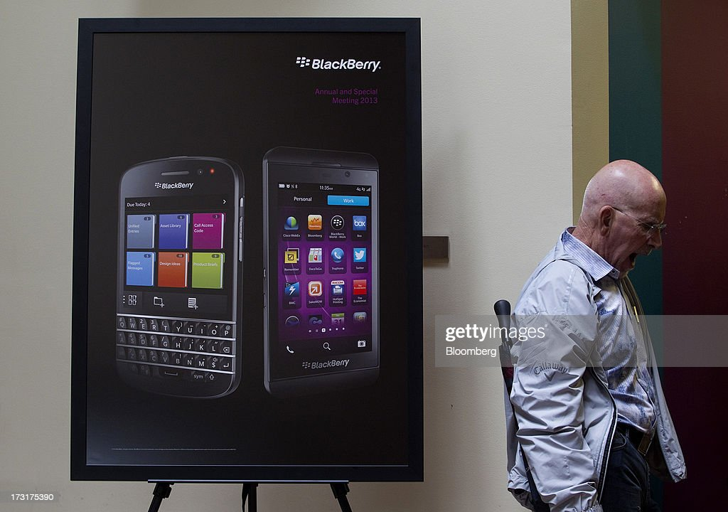 An attendee yawns before the start of the BlackBerry annual general meeting in Waterloo, Ontario, Canada, on Tuesday, July 9, 2013. BlackBerrys chances of becoming a viable contender to Apple Inc. and Google Inc. in the smartphone market are dimming amid lackluster demand for its flagship touch-screen device. Photographer: Pawel Dwulit/Bloomberg via Getty Images