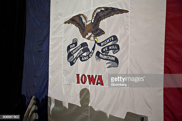 An attendee's shadow is cast on an Iowa state flag before Senator Marco Rubio a Republican from Florida and 2016 presidential candidate not pictured...