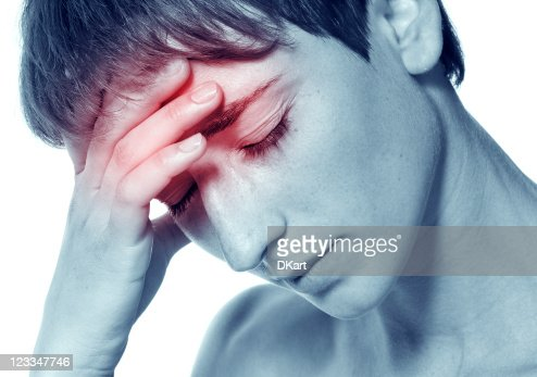 An attractive young woman with migraine pain