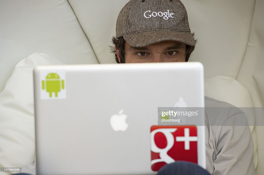 An atttendee works on his computer during the Google I/O conference in San Francisco, California, U.S., on Thursday, June 28, 2012. Google Inc., owner of the world's most popular search engine, unveiled a cloud-computing service for building and running applications to help woo customers and challenge Amazon.com Inc.'s Web Services. Photographer: David Paul Morris/Bloomberg via Getty Images