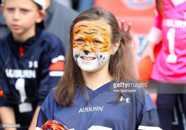 An Auburn fan cheers on her team during a football game between the Auburn Tigers and the LouisianaMonroe Warhawks Saturday November 18 2017 at...