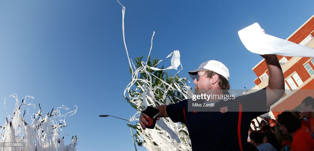 An Auburn fan throws a roll of toilet paper at the Auburn Oaks during the Toomer's Corner Celebration on April 20, 2013 in Auburn, Alabama.