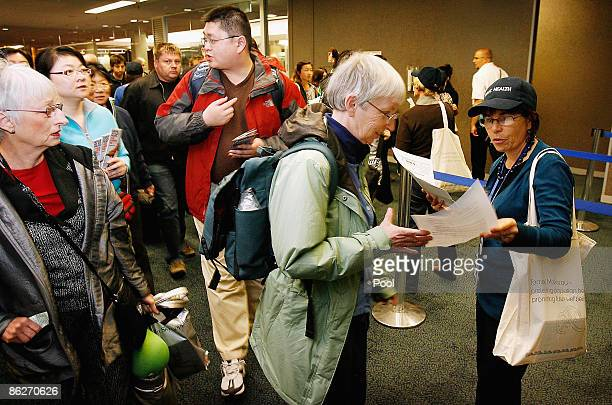 An Auckland Health Official hands out information to arriving passengers from the United States at Auckland International Airport on April 29 2009 in...