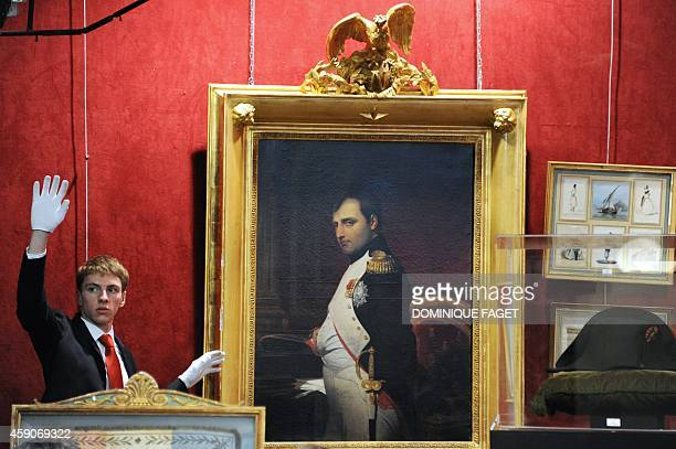 An auction house employee gestures next to a portrait of French Emperor Napoleon I painted in 1807 by French painter Paul Delaroche estimated at 35...