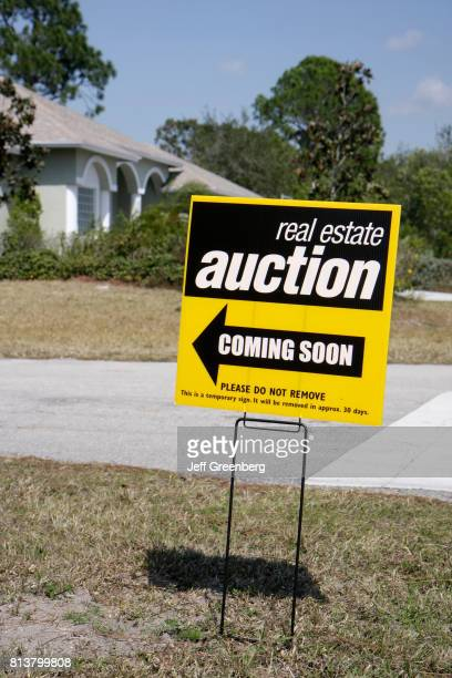 An auction sign for houses at Port Saint Lucie