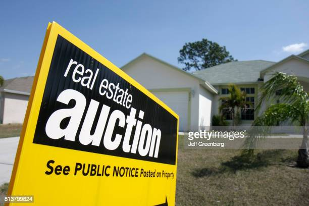 An auction sign in front of a house at Port Saint Lucie