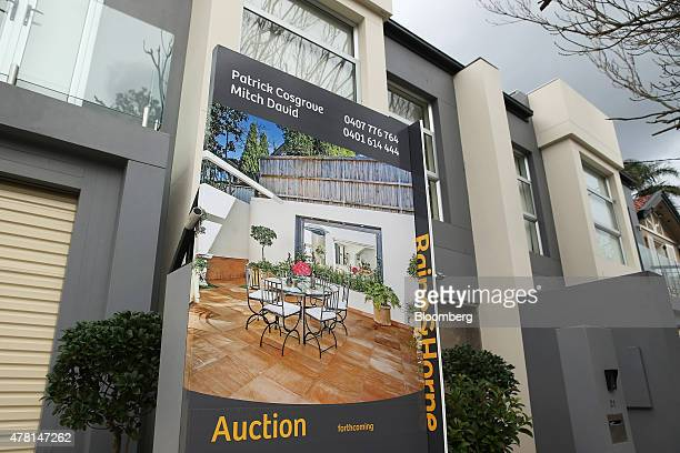 An 'Auction' sign is displayed outside a house in the suburb of Double Bay in Sydney Australia on Thursday June 18 2015 Surging home prices in cities...