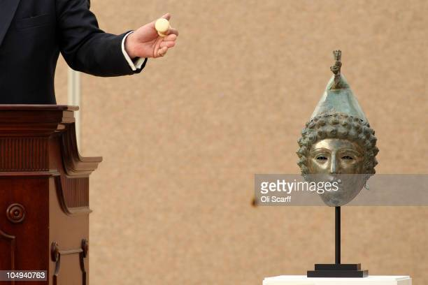 An auctioneer for Christie's sells The Crosby Garrett Helmet for 23 million GBP to a telephone bidder on October 7 2010 in London England The Roman...
