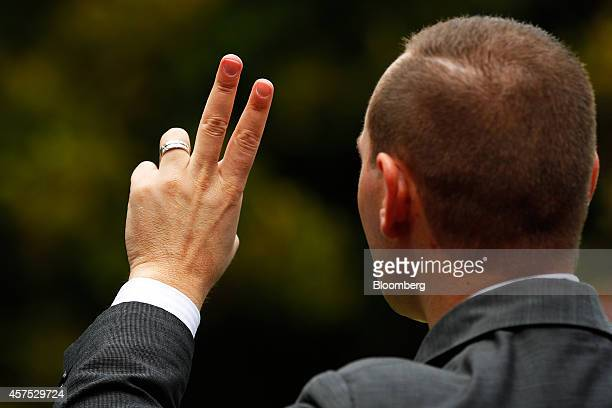 An auctioneer gestures while conducting bidding during an auction of a property in the suburb of Roseville Sydney Australia on Saturday Oct 18 2014...