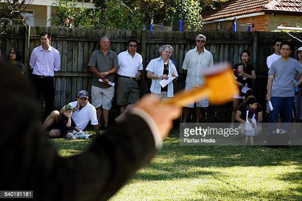 An auctioneer waves the hammer during an auction of a property in Hobart Ave in the Sydney suburb of East Lindfield 24 March 2007 SHD Picture by PER...