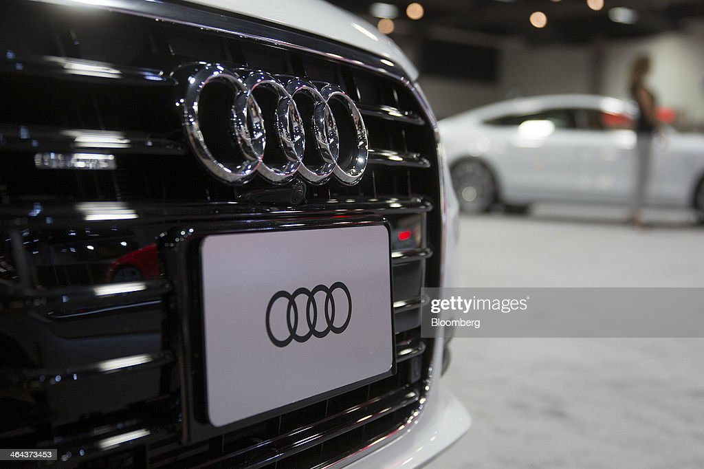 An Audi AG A6 TDI vehicle sits on display during the Washington Auto Show in Washington, D.C., U.S., on Wednesday, Jan. 22, 2014. Audi, Bayerische Motoren Werke AG (BMW) and Mercedes-Benz are targeting at least a fourth consecutive year of record sales in 2014 as new compacts tighten the race among the German rivals for the luxury-car industry's lead. Photographer: Andrew Harrer/Bloomberg via Getty Images