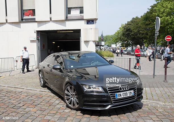 An Audi AG automobile carrying Dominique StraussKahn the former head of the International Monetary Fund leaves the courthouse in Lille France on...