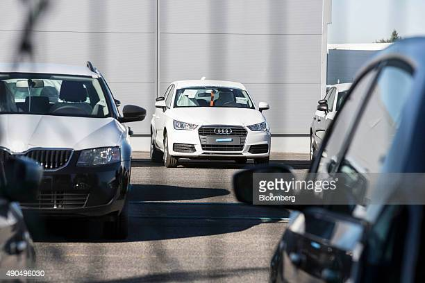 An Audi AG automobile produced by Volkswagen AG sits with other new cars in a parking lot outside a VW logistics park ahead of shipping in...