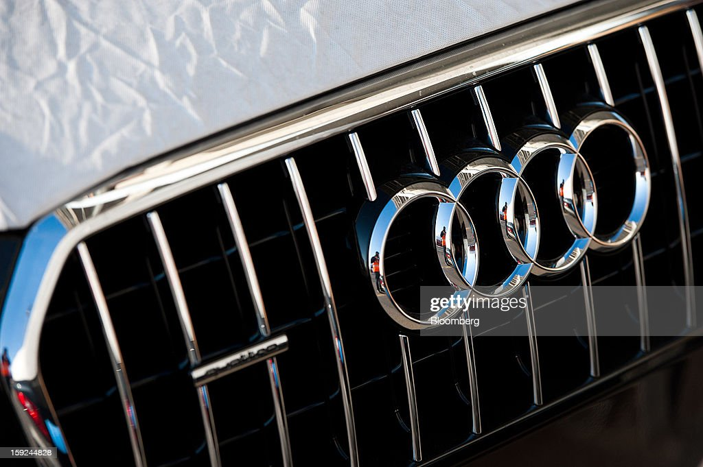 An Audi AG badge sits on the grille of a new Audi Q3 automobile ahead of shipping at Barcelona port in Barcelona, Spain, on Thursday, Jan. 10, 2013. Spanish exports grew the least in five months in September as the euro area relapsed into a recession and the region's fourth-largest economy continued to contract. Photographer: David Ramos/Bloomberg via Getty Images