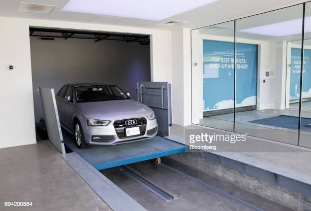 An Audi AG vehicle enters the showroom at the Carvana Co car vending machine in Frisco Texas US on Thursday June 8 2017 The US automotive industry...