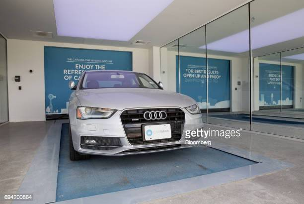 An Audi AG vehicle enters the showroom of the Carvana Co car vending machine in Frisco Texas US on Thursday June 8 2017 The US automotive industry...