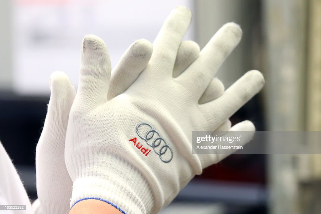An Audi employee at the company's plant in Ingolstadt, Germany, on Monday, March 11, 2013. Audi is set to spend 13 billion euros ($17 billion) through 2016 to expand and develop new cars pursuing BMW's sales lead.