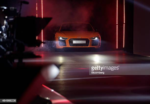 An Audi R8 V10 plus automobile produced by Audi AG is driven onto the stage during its unveiling at Volkswagen AG's preshow event ahead of the 85th...