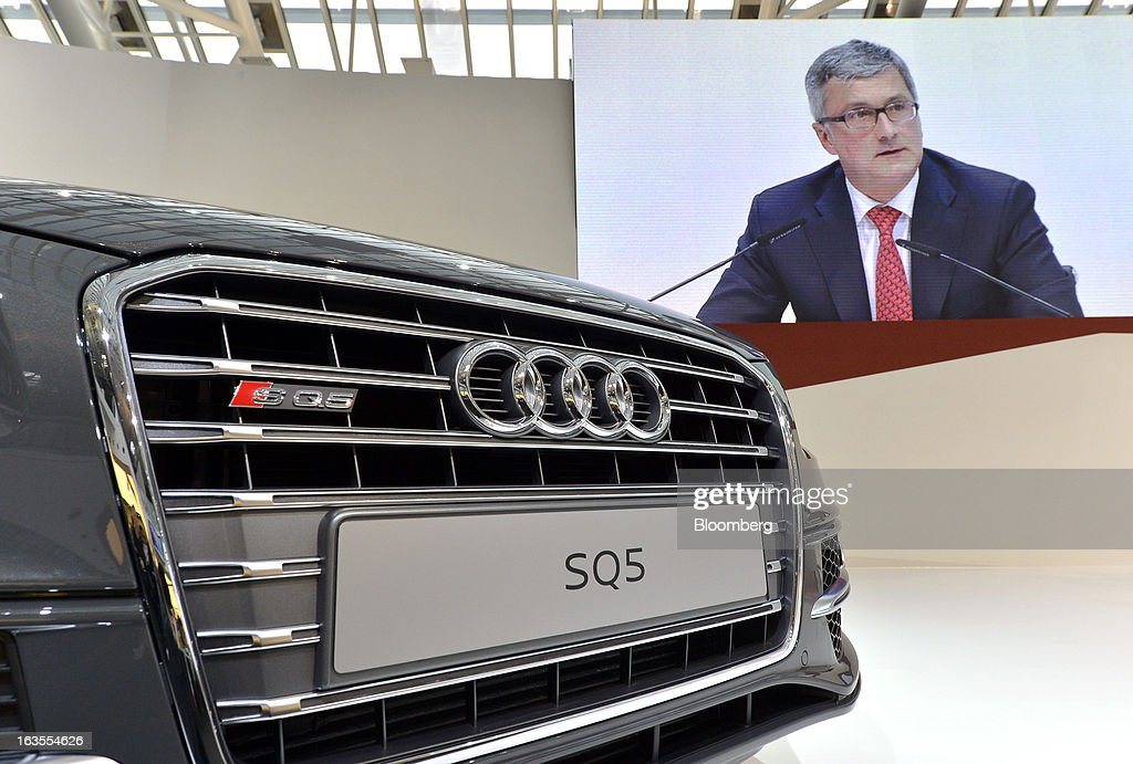 An Audi SQ5 automobile is seen on display as <a gi-track='captionPersonalityLinkClicked' href=/galleries/search?phrase=Rupert+Stadler&family=editorial&specificpeople=870122 ng-click='$event.stopPropagation()'>Rupert Stadler</a>, chief executive officer of Audi AG, speaks during the company's earnings news conference at the Audi AG headquarters in Ingolstadt, Germany, on Tuesday, March 12, 2013. Audi AG, the world's second-biggest luxury carmaker, is aiming for a 'slight' increase in revenue this year and reaching an operating margin at the upper end of its long-term target corridor, helped by sales of compact SUVs and the new A3 sedan. Photographer: Guenter Schiffmann/Bloomberg via Getty Images