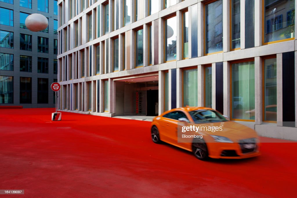 An Audi TT automobile passes the headquarters of Raiffeisen Group in St. Gallen, Switzerland, on Wednesday, March 20, 2013. Wegelin & Co., who sold Notenstein Privatbank AG to Raiffeisen Group last year, were ordered to pay U.S. authorities almost $58 million at the end of a criminal case after the Swiss bank pleaded guilty to helping American taxpayers hide more than $1.2 billion from the Internal Revenue Service. Photographer: Gianluca Colla/Bloomberg via Getty Images